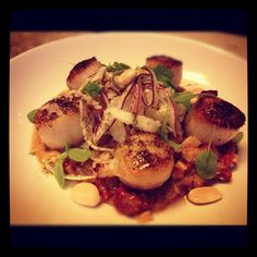Pan Seared Scallops with a cauliflower puree, fennel, red onion, almond salad, and sorrel oil :: Photo by tguan89 • Instagram