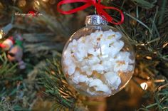 25 ideas for decorating clear glass ornaments. some unpooped popcorn in a glass ornament. remove metal parts. A cotton ball to plug the neck. Set on some paper towel on a saucer. Microwave to pop the kernels. Ornament WILL be HOT, so don't touch!!Remove from microwave by handling the saucer.