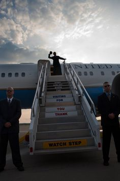 Vice President Joe Biden throws a football from the top of the stairs before boarding Air Force Two at Pittsburgh International Airport in Pittsburgh, PA, July 1, 2009.