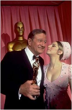 John Wayne wins the Oscar for True Grit, at the 1970 Oscars.The Duke is pictured here with Barbra Streisand, who presented Wayne with his Oscar Hollywood Icons, Golden Age Of Hollywood, Hollywood Stars, Classic Hollywood, Hollywood Party, John Wayne, Classic Movie Stars, Classic Films, Academy Award Winners