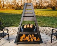 Metal fire pit chiminea with wood storage Fire Pit Art, Fire Pit Uses, Metal Fire Pit, Wood Burning Fire Pit, Diy Fire Pit, Fire Fire, Garden Fire Pit, Fire Pit Backyard, Backyard Bbq