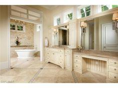 2550 Escada Ct, Naples, FL 34109 | Master bathroom with soaking tub and floor tile details.  Escada at Tiburon