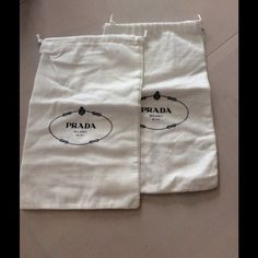 SHOE COVERS White felt with black drawstrings, with the authentic PRADA logo.  Use these to store your originals, or your favorite pair of shoes.  These are great for travel, can be hand washed, and have numerous uses besides storing your shoes.  SOLD AS A PAIR ONLY Prada Accessories