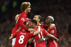 The United forward is mobbed by team-mates after his stunning opening strike…