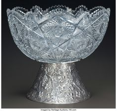 A CUT-GLASS PUNCH BOWL WITH SILVER REPOUSSÉ BASE, late 19th century Marks: 925 16-1/2 inches high x 18 inches diameter (41.9 x 45.7 cm) 51.95 troy ounces.