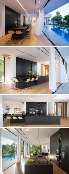 This matte black kitchen is a strong contrast the the rest of the house, where the walls are mostly white. A long island creates plenty of counterspace and acts as a casual dining area, while the wall is home to floor-to-ceiling cabinetry, allowing for plenty of storage.