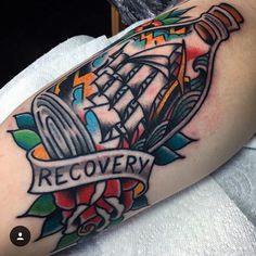 Ship in a bottle tattoo done by Chris Martin
