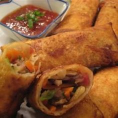 Authentic Chinese Egg Rolls With Vegetable Oil, Eggs, Cabbage, Carrots, Bamboo Shoots, Wood Ear Mushrooms, Pork, Green Onions, Soy Sauce, Salt, Sugar, Msg, Egg Roll Wrappers, Egg Whites, Oil