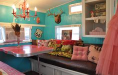 Glamping Camper is very eclectic. Love the chandelier and antlers.