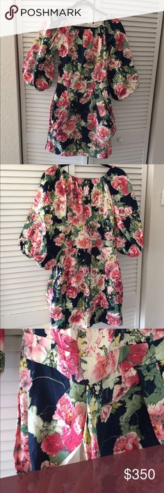 Very beautiful floral prints dress Brand new without tag, size European size 40, super unique design, great fabrication, and awesome details, two side pockets with side zipper, and spandex in the shoulders and sleeves area, very clean finishing with lining, feels real nice and well made, love this dress Dresses