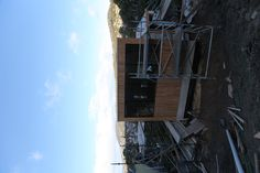 Cladding going on the road facing side of house. Liverpool Cres, Build for Dock 4 Architects. 2012.