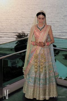 Bridal Wear - Vidhu & Tania wedding story | WedMeGood | Bride in an Anita Dongre Pink and Blue Lehenga with a Diamond and Emerals Set #wedmegood #indianbride #indianwedding #bridallehenga #weddinglehenga #anitadongre