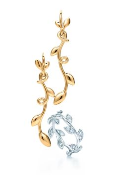 Paloma Picasso® Olive Leaf vine drop earrings in 18k gold and band ring in 18k white gold with diamonds.