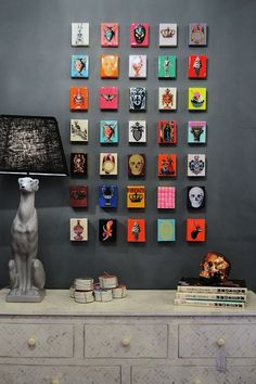 Gretchen says: Cards, postcards, stickers-anything you love can be made into a cute gallery wall like this!