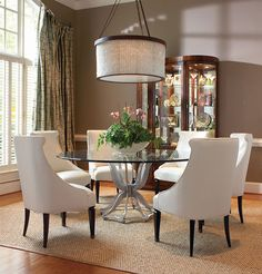 The Century Furniture Omni Metal Base Dining Table With Glass Top perfectly showcases the contemporary aesthetic of the Omni collection- cool, powerful, curvaceous, understated, geometric, sophisticated, and warm.