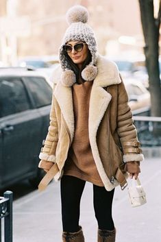 Loving this Beanie with fur moms on Giovanna Battaglia Engelbert paired with a camel jacket and a sweater. Now this is what you call winter dressing done right!