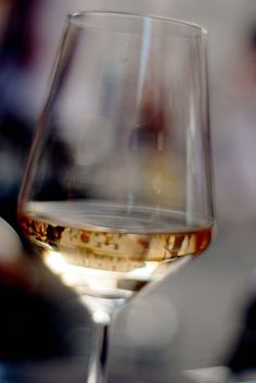 close up of white wine in long stemmed glass