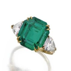 The emerald weighing 6.88 carats, flanked by pear-shaped diamonds weighing 1.50 carats, mounted in 18 karat gold, size 5½, signed Van Cleef & Arpels, numbered N.Y. 50365. With signed pouch. Est. 100,000—150,000 USD - Hammer Price with Buyer's Premium:  164,500 USD