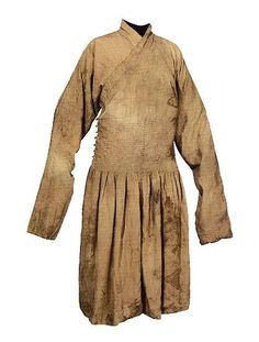 Yuan Dynasty. Damask robe with ribboned waist decoration. This Mongolian robe of the Yuan dynasty has a flat crossing collar, narrow sleeves and waist and silk tying ribbons. It is 126 cm in length, 218 cm across the sleeves, 110 cm wide at the robes skirt and 49 cm at the waist The collar is 7.2 cm wide. Eighteen silk ribbons with a width of 0.7 cm have been stitched horizontally around the waist to form a broad band some 18.5 cm in width, which visually is not unlike the modern cummerbund.
