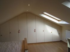Attic built-in wardrobes Attic Conversion, Built In Wardrobe, Wardrobes, Cupboard, Garage Doors, Loft, Bedroom, Building, Wall