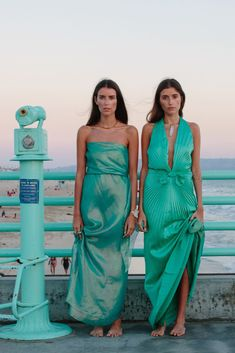 "This Street Style Sister Duo Has Us Seeing Double #refinery29  http://www.refinery29.com/matching-fashion-sisters#slide-2  Jess: ""Channeling mermaids on Manhattan Pier in these vintage gowns from Decades in L.A.""Stef: ""This was part of the Twogether Project, which was a series of photos we took to showcase thoughtful fashion and document our travels."""