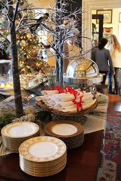 This tablescape is a bit much for my family's table, but the tree look might be nice on a buffet table or a sofa table - Mary Carol Garrity Holiday home tour 2012