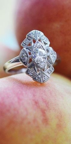 This unique, vintage engagement ring is absolutely stunning.