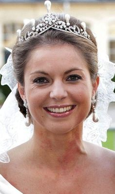 Princess Annemarie, Duchess of Parma and wife of Prince Carlos, Duke of Parma, wearing the Emerald Parure Tiara (pearl setting), The Netherlands (pearls, diamonds).