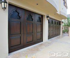 Borrowed Indian Architectural Details on a Custom Wood Garage Door - eclectic - garage and shed - orange county - Dynamic Garage Door