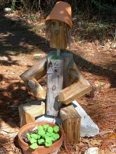 Fun garden guy!  Hmmmm... those fence post scraps might come in handy...