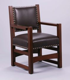 Early Gustav Stickley armchair #1296A with leather-upholstered back c1901-1902.  Unsigned.  Very nicely refinished.  Very sturdy.