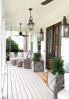 Beautiful Southern porch with Bevolo lanterns, ceiling fans, and outdoor furniture. Linen Southern Front Porches, Country Porches, Country Porch Decor, White Exterior Houses, Porch Entry, Entry Doors, Fireplace Remodel, Porch Lighting, Porch Decorating