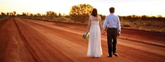 There's no need for red carpet, when you have nature's own red earth for your special day. Ayers Rock Resort - Outback Australia