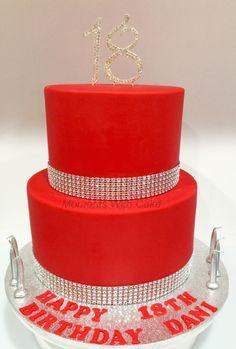 Red 2 tier 18th birthday cake. Chocolate mud and white mud filled with ganache. Diamanté number 18 and diamanté wrap. Simple but elegant.