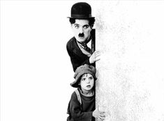 Charlie Chaplin and Jackie Coogan in The Kid directed by Charlie Chaplin, 1921