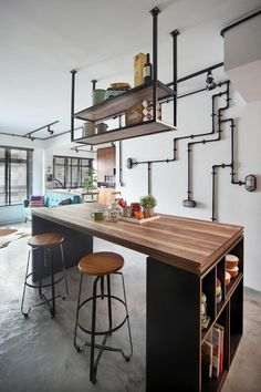 Exposed pipes and beams are a staple of the industrial style.