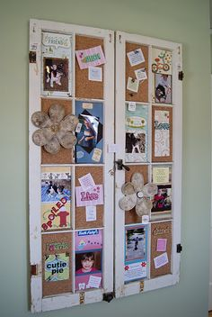 window frames with cork covering the squares...cute bulletin board idea for the girls room