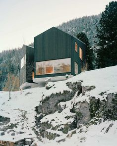 Lacroix Chessex Architectes realized La Maison aux Jeurs, a cabin in Les Jeurs, Switzerland situated on a rocky hill above the road. The structure is divided into two volumes that are angled 45 degrees apart with a connection on the mountain side. Both volumes are designed with different views of the valley below.