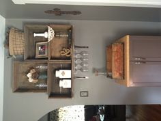 Old wooden boxes bolted to the wall. Wine bar and coffee bar. Wine rack.
