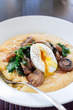 "Cheesy Polenta with Caramelized Onion, Mushroom, Kale, and Egg - could use grits or a ""homemade"" corn tortilla"