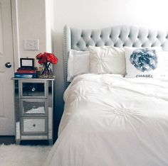 This bedroom feels very airy. Love the headboard.