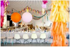 cool rentals | plus i love the color + balloons + tissue fringe + garlands of this setup