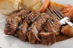 #CrockpotBeef Roast with potatoes, garlic, and herbs. It's so good!