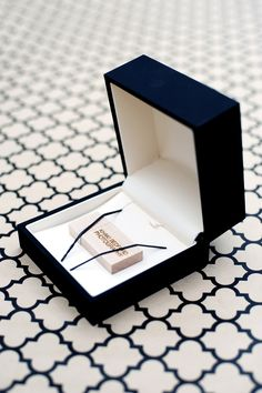 Wedding photography packaging - customized bamboo flash drives delivered to the client in this nice box! © Khaki Bedford Photography