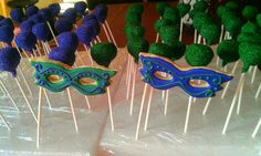 Purple and green cake pops with masquerade cookies.