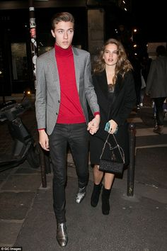 Slick: The 18-year-old supermodel looked dashing in a roll neck while his stunning partner, 26, slipped into a tight lace dress which flashed a hint of her burgeoning bump while covering up in a cosy coat over the top