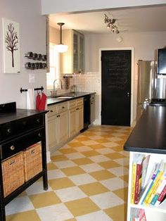 If we have to redo the kitchen in our next house, I'd like to do VCT flooring in green and white checkerboard.