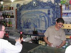 Best place in Lisbon to enjoy a Ginja (liqueur made of berries) & city center tourist attraction.    This is a very tiny bar where a maximum of three people can go in at a time and order a Ginja.    Here you can take a look to the Nacional Theater D. Maria II.