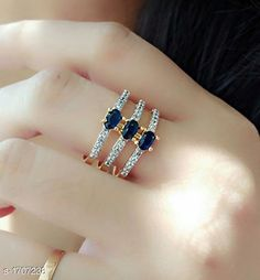 Rings Women's American Diamond Rings Material: Alloy  Size: Free Size (Adjustable) Description: It Has 1 Piece Of Finger Ring Work: Stone Work Sizes Available: Free Size *Proof of Safe Delivery! Click to know on Safety Standards of Delivery Partners- https://ltl.sh/y_nZrAV3  Catalog Rating: ★4 (6485)  Catalog Name: Women's Partywear American Diamond Rings CatalogID_223180 C77-SC1096 Code: 441-1707238-