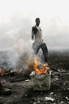 Looks like an apocalypse - it's man-made: African workers burning computers to harvest copper wire, breathing in mercury fumes that kill them. Great photo-journalism.